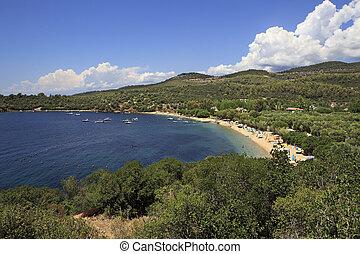 Public beach in the beautiful bay of the Aegean Sea.