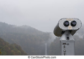 Public Binoculars Machine with the fog in Autumn at Akechidaira Ropeway ,Nikko in Japan