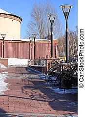 Public garden with lanterns and benchs