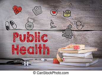 Public Health. Stack of books and a stethoscope on a wooden background