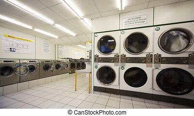 Public laundry with large washing machines - public laundry...