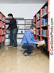 Public Library - Two men, looking throught the books in...