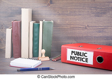 Public Notice. Binder on desk in the office. Business background