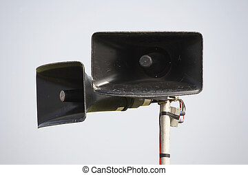 public pa address system speakers on a metal pole