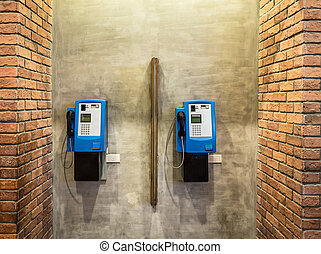 Public payphones on the wall