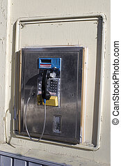 Public phone on wall