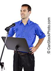 Public Speaker - businessman on a podium making a speech or...