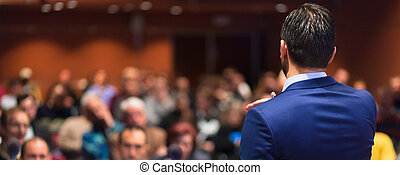 Public speaker giving talk at Business Event. - Rear view of...