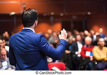 Public speaker giving talk at Business Event. - Speaker...