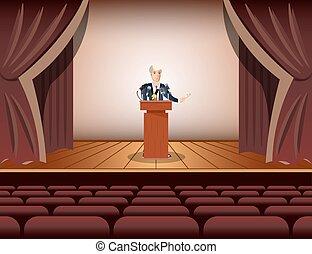Public speaker standing and speaking to microphones.