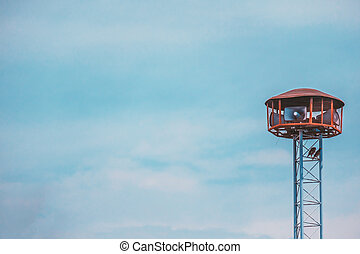 Public speaker tower against blue sky