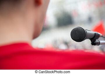 public speech - political concept, focus point on black mic...