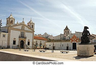 Public square in Faro, Portugal churches in view under a ...