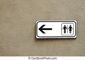 public toilet sign on a wall