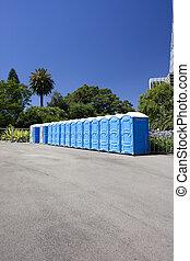 Public Toilets - Image of public toilets in a row.