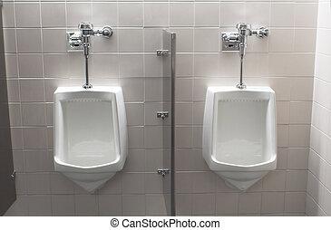 Industrial urinals in a public mens room.
