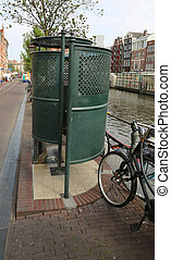 public urinal on a street near the navigable canal in...