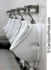 Public urinals - Row of urinals in a public toilet