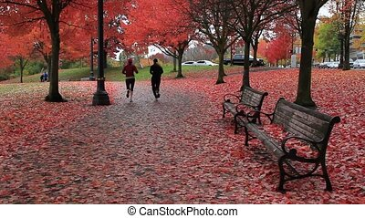 Public Waterfront Park Portland OR - Female Joggers running...