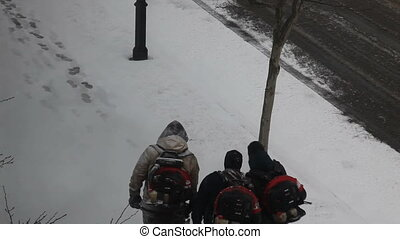 Public workers remove snow - Three people blowing snow off...