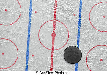 Puck on a hockey rink - Puck lying on the ice hockey rink....