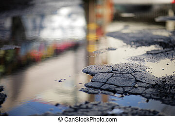 Puddle of water, shallow DOF.