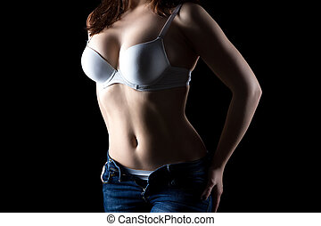 Pudgy girl in white bra, no face on black background