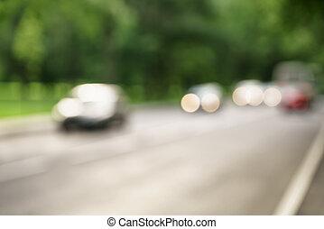 pueblo, callejón, con, árboles verdes, plano de fondo, y, tráfico coche