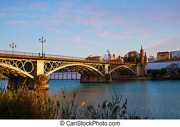 Puente Isabel II bridge sunset in Triana Seville of...