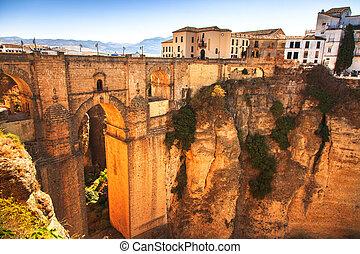 Puente Nuevo or New Bridge historic landmark and el tajo gorge in Ronda, white village building on the rocks. Andalusia, Spain.