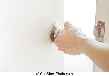 puerta de inauguración, perilla, mano, blanco