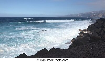 Puerto de la Cruz, Tenerife - Atlantic ocean with waves at...