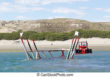 Tractor used to move boats to the temporary dock at low tide in Puerto Piramides in the Valdes Peninsula, on the Atlantic Ocean, Argentina