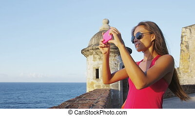 Puerto Rico woman taking pictures at Old San Juan Castillo ...