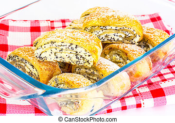 Puff buns with cottage cheese and poppy seeds in a glass baking