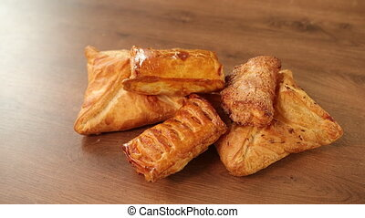 Puff pastry filled. Patisserie with cherry filling. Rolls. Cookies triangles
