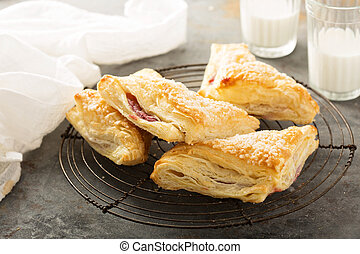 Puff pastry with cherry filling and milk
