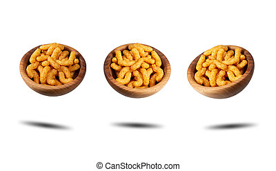 Puffed peanuts snacks in wooden bowls. Isolated.