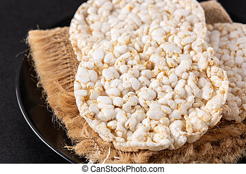 Puffed rice cakes on black background