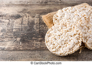 Puffed rice cakes on wooden table. Copy space