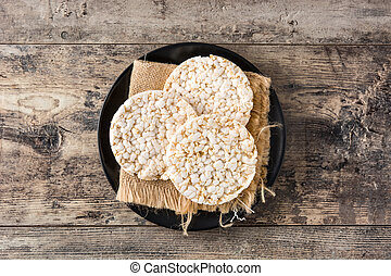 Puffed rice cakes on wooden table