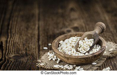 Puffed Rice (detailed close-up shot) on vintage wooden background