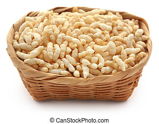 Puffed rice in a basket over white background