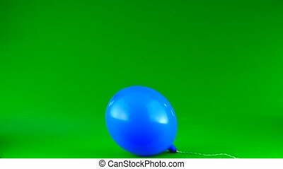 puffy blue ball on a green background