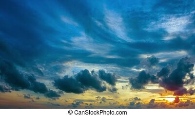 Puffy Clouds Drifting across a Colorful, Tropical, Sunset...