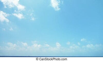 Puffy Clouds Drifting over a Calm Sea. Video 1080p FullHD -...