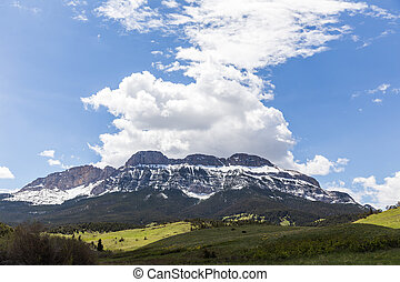 Puffy Clouds Over Rocky Mountains