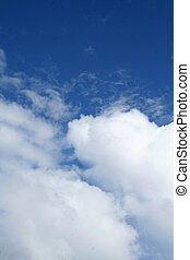 Puffy white clouds on a brillant sky day