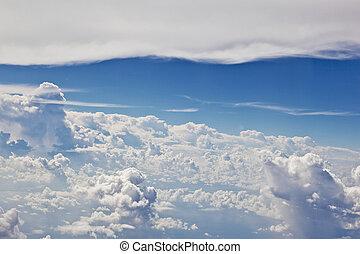 puffy white cloud blue sky