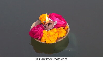 puja flowers and candle on Ganges - puja flowers and candle...